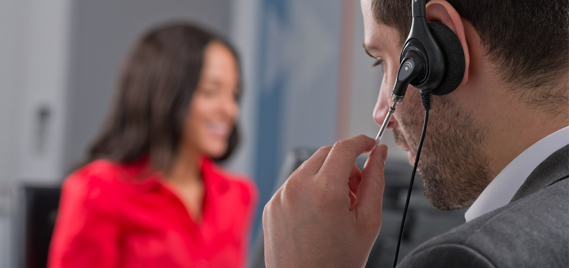 Photograph of man using telephone headset