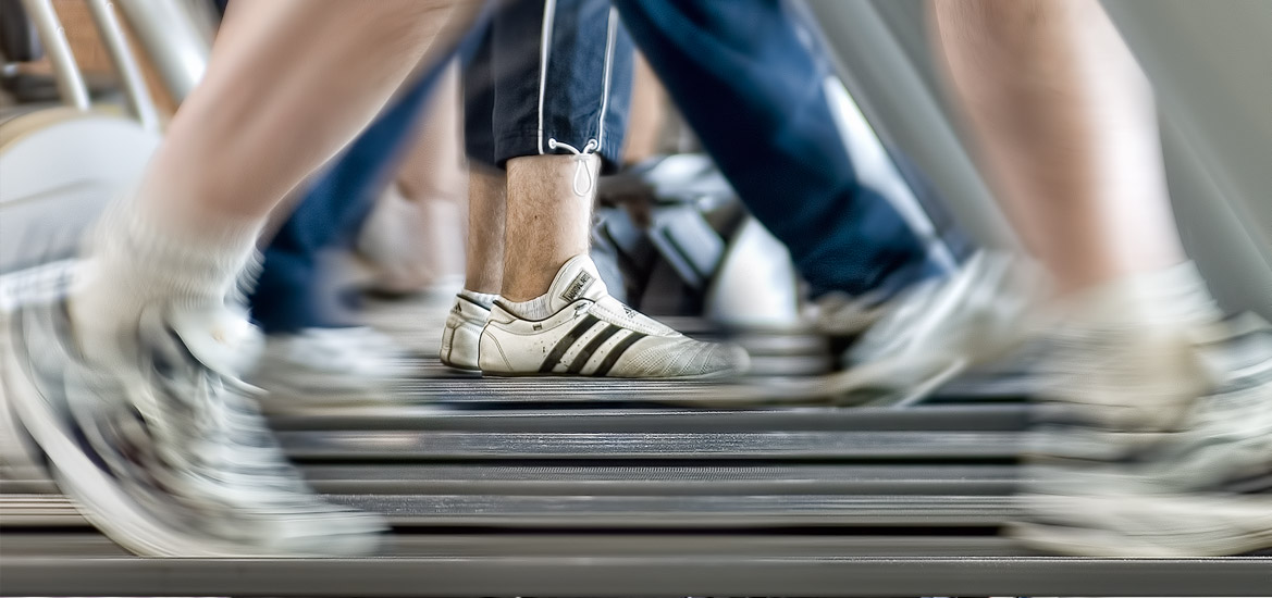 Runners on running machines in a gym