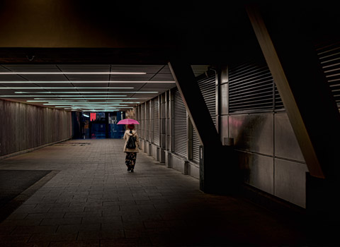 Person with an umbrella in the Broadgate Centre