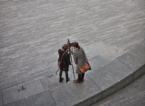 Two people using a video camera