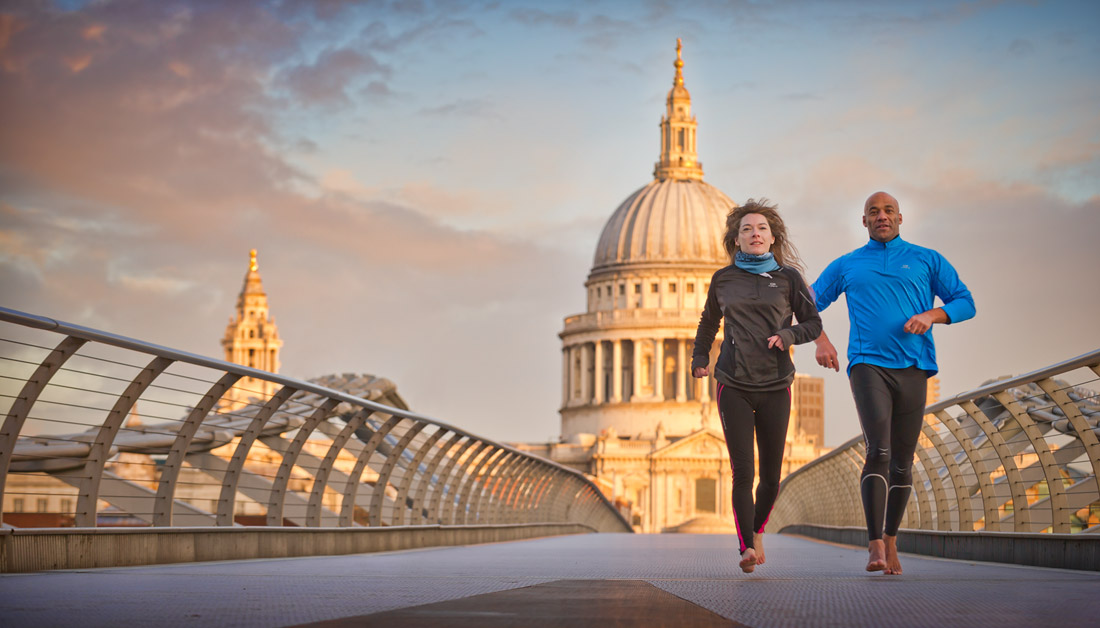 Two people running with St Paul's Cathedral in the background